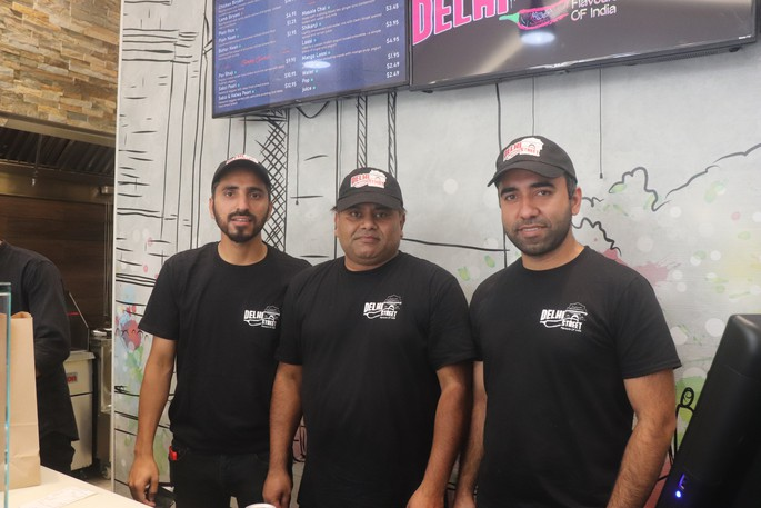Delhi Street Restaurant has been running at McAllister Place for nearly two weeks since opening its doors on Aug. 12, which is also the birthday of Chef Guljar Ahmed. Pictured here with Ahmed, centre, are fellow business owners Anas Tavrez, left, and Shabahat Shakeel, right.