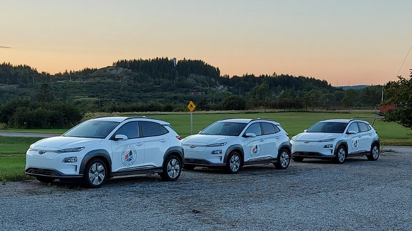 Three of the four electric vehicles, purchased by Eastern Charlotte Waterways, for its on-demand public transportation project set to start this fall.