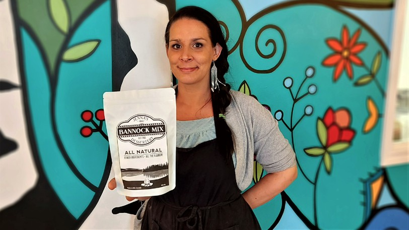 Jenna White holds up a bag of Bannock Mix in Jenna's Nut-Free Dessertery, which she opened in May in Fredericton's industrial park. White has been selected as a semifinalist in the seventh annual Pow Wow Pitch, a competition for Indigenous entrepreneurs, where she could win as much as $25,000