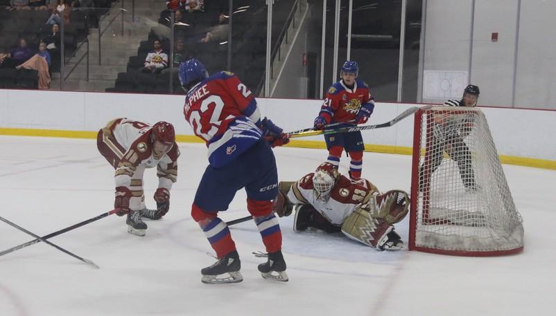 Moncton Wildcats' Luke McPhee scores the winning goal on Acadie-Bathurst Titan goaltender Chad Arsenault in the third period of a QMJHL pre-season game on Wednesday the UNIplex in Dieppe. At right is Wildcats forward Alex Mercier.