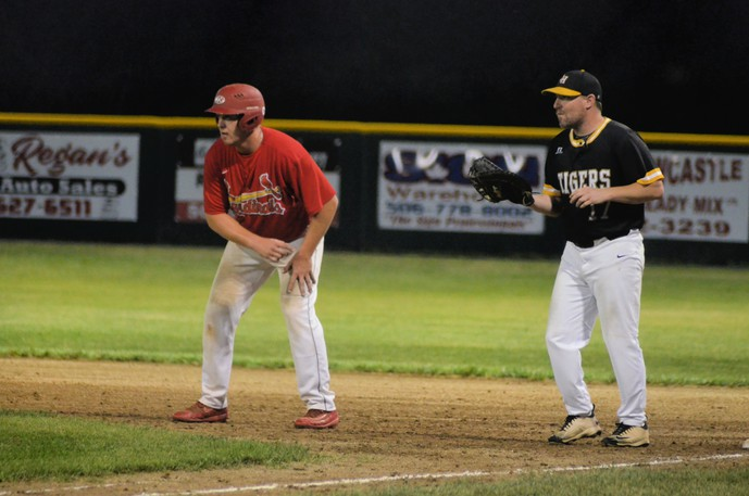 Billy Gaston, left, of the Miramichi Mike's Bar and Grill Cardinals attempts to advance to second base while Chatham Head Tigers first-baseman Nick Hardy waits for a chance to pick him off Tuesday during Game 3 of the best-of-five Miramichi Valley Baseball League semifinals at Waldo Henderson Memorial Field. The Tigers won 6-5 to take a 2-1 series lead in the best of five series.