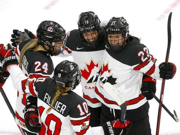 Canadian players celebrate a goal by Melodie Daoust against Switzerland during the IIHF women's world championship at WinSport Arena in Calgary on Tuesday, Aug. 24, 2021.