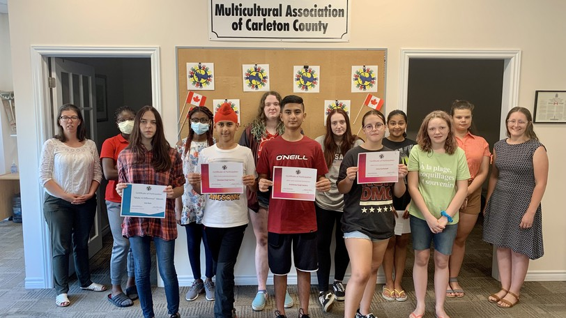 Certificates were handed out to youth who participated in two summer programs offered by the Multicultural Association of Carleton County. Front row, from left: Liza Kvin, Ekam Singh Seehra, Arsh Singh Seehra, Luiza Garbelotti, Edith Webster-Snoad. Back row, from left: MACC Schools Program Coordinator Amy Anderson, Temilade Adeniyi, Faith Odetola, Brooke Webster-Snoad, Becky Webster-Snoad, Farida Soror, Aryna Zhaulakova, MACC Community Involvement and Volunteer Coordinator Melissa Williams. Absent are Nikita Pozyvai, Oleksandra Mykhnevych, and Mariia Viktoriia Mkyhnevych.