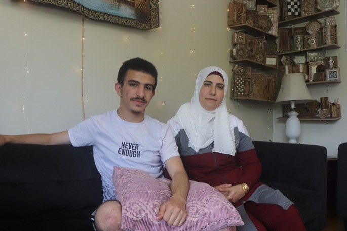 Syrian refugees Firas Al-Asali and his mother Samar Alawad, along with father Amer Al-Asali who isn't pictured here, are working to bring the remainder of their extended family to Saint John.