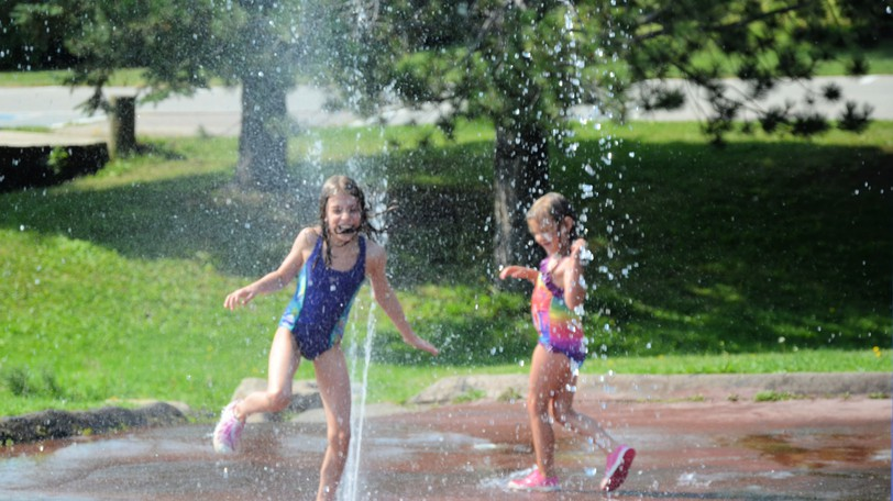 Ten-year-old Annie Dugasand five-year-old Delaney LeFebvre enjoy the splash pad Thursday at Ritchie Wharf Park while visiting Miramichi from Ottawa and Red Deer, Alta., respectively. The duo is among many kids to use the splash pad to beat the recent heat. While Thursday's daytime high was 31 C and overnight low was 17 C, Environment Canada's forecast includes cooler temperatures this weekend, with highs of 22 C Friday, 20 C Saturday, and 24 C Sunday.