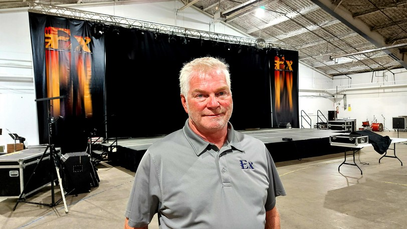 Mike Vokey, executive director of the New Brunswick Provincial Exhibition, stands in front of the stage where indoor shows will be performed during NBEX. Proof of full vaccination will be required as a precaution due to the COVID-19 pandemic, which led to the cancellation of the NBEX in 2020.