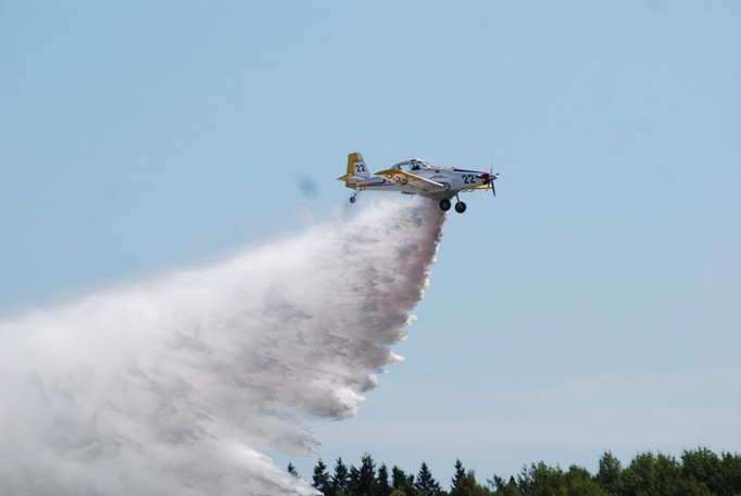 The Forest Protection Limited pilot whose water bomber crashed into a hillside Aug. 11 while fighting a forest fire near Popple Depot has returned to work, company officials say.