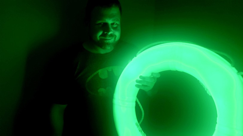 Scott Harrigan shows off a glowing life ring, one of the Glorope products he produces at his New Brunswick production facility.