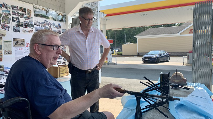 Carleton Co-Op Office Manager Doug Thomson shows Florenceville-Bristol Mayor Karl Curtis old equipment from the business's butter creamery days. The business celebrated 75 years with a barbecue on Thursday afternoon.