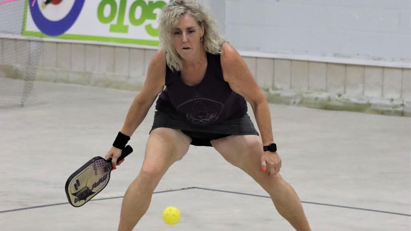 Pickleball Saint John club member Lisa Weir tracks the ball during a match at Thistle-St. Andrews Curling Club.