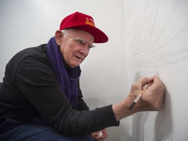 Renowned Canadian conceptual artist Garry Neill Kennedy, who suffers from dementia and Alzheimer's, is seen Oct. 26, 2018 working on his project Remembering Names, in which he drew all the names of people he can remember on the wall of the CSA Gallery in Vancouver, B.C.