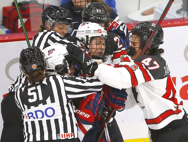 Tempers flare between Team Canada and Team USA in second period action during the 2021 IIHF Women's World Championship at the Winsport arena in Calgary on Thursday, August 26, 2021.