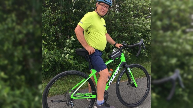 Avid Beresford cyclist Jean-Pierre Hachey tested out the new green trail connecting Bathurst to Beresford Wednesday night. He is pictured cycling on a trail out of town.