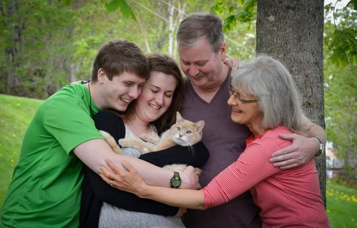 Multiple myeloma survivor Sally Crate, far right, is pictured here with her family, left to right, Mike Crate, Jenn Martin and John Crate, with their cat Eddy.