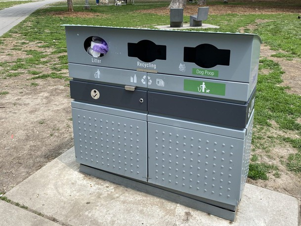 One of the City of Toronto bins to collect dog waste as part of a pilot project is seen at Victoria Memorial Square Park, at Wellington and Portland Sts., on May 15, 2021. A dog owner had just placed a bag of dog waste in the slot marked Litter.