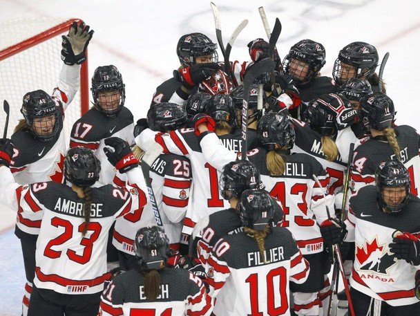 Canadian players celebrate after a 5-1 win over the U.S. at the IIHF Women's World Championship at the Winsport arena in Calgary on Aug. 26, 2021.