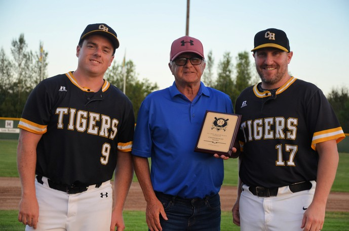 Brian Dunn, left, and Nick Hardy, right, of the Chatham Head Tigers accept the Miramichi Valley Baseball League Team Award from league president Billy Fleiger.