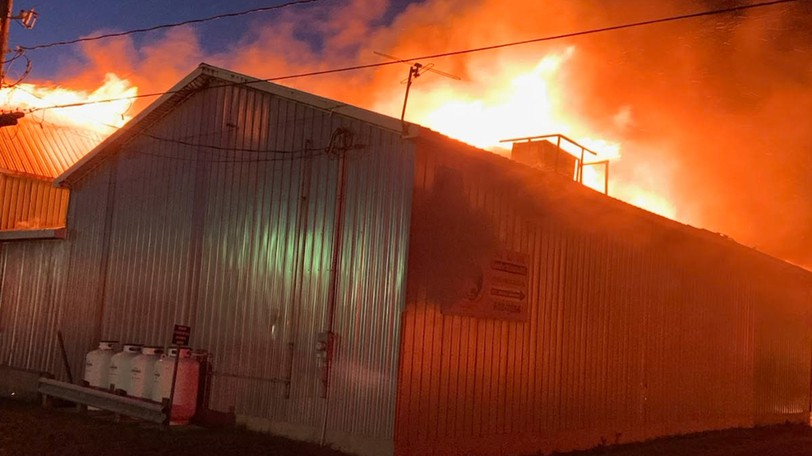 Flames largely destroyed an M&M Cormier Fisheries facility on Route 950 in Petit-Cap early on Aug. 28, 2021.