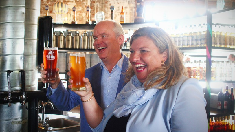 Erin O'Toole and his wife Rebecca raise a glass at Picaroons following a Conservative campaign event on Saturday morning.