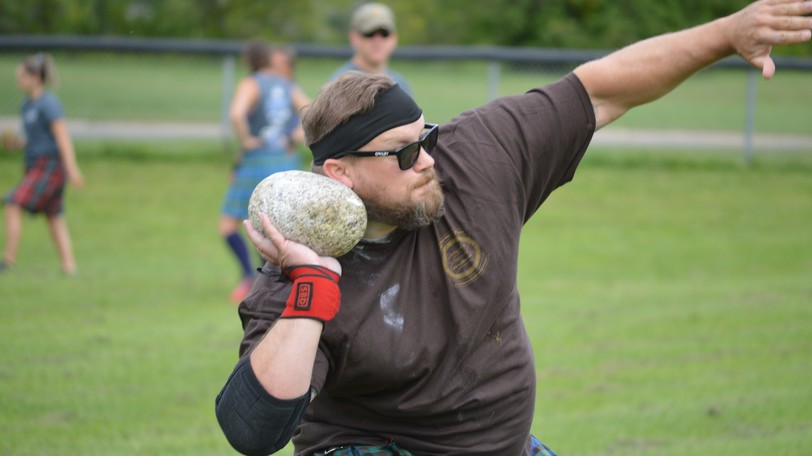 R.J. Forbes gathers his strength as he gets ready to toss the stone during the Highland Games held in Perth-Andover. Scottish heavy events were held under sunny skies at Veterans Field throughout the day.