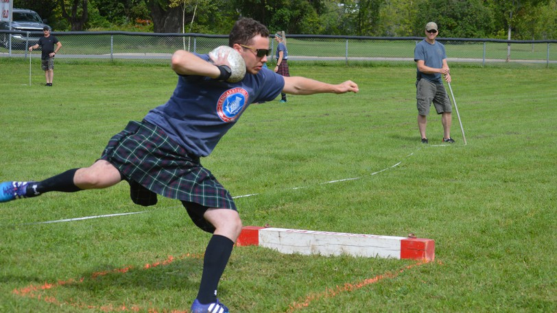 Ryan Kennedy of Nova Scotia gets momentum from his spin during the open stones event at Perth-Andover's Highland Games held on Saturday.