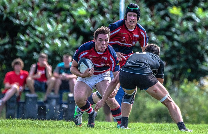 Fredericton Loyalists' Branden Howe tries to elude a Moncton Black Tide tackler in New Brunswick Rugby Union senior A men's action Saturday at Loyalist Field. Fredericton rallied for a 30-29 win.