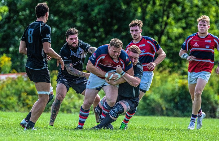 Fredericton Loyalists' Justyn Roberts is tackled by a Moncton Black Tide player in New Brunswick Rugby Union senior A men's action at Loyalist Field. The Loyalists, who rallied for a 30-29 win, host the Saint John Trojans at 2 p.m. Saturday.