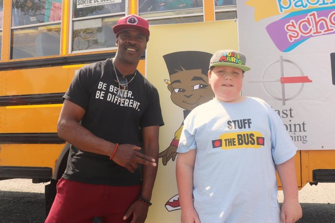 """On Aug. 27, Maestro Fresh Wes attended the Saint John Stuff the Bus event at East Pointwhere he gave a reading of the first chapter of his book """"Stick To Your Vision, Young Maestro Goes To School."""""""