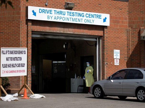 Cars are directed into the drive-thru COVID-19 testing centre at the Richmond Road Diagnostic and Treatment centre in Calgary on Tuesday, Aug. 24, 2021.