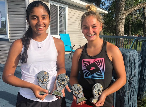 Fredericton's Vanya Virmani, left, defeated Olivia Larsen, right, in both the U16 and U18 girls singles finals at the Dieppe Juniors tennis tournament.