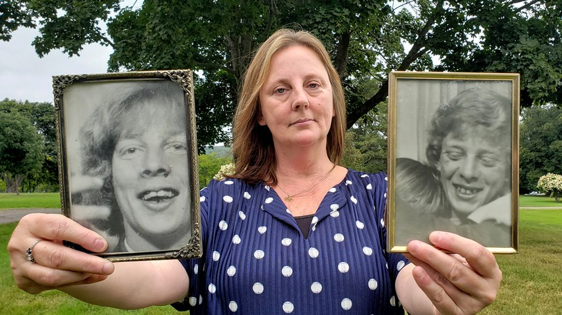 Trudy Urquhart holds up photos of her brothers Ronnie, left, and Donnie Urquhart, 16-year-old twins who were killed in a mysterious hit-and-run accident in Upper Blackville in August, 1972. The photos were taken the month they died. Neither the  driver or the vehicle were never found, a mystery which has haunted the family for decades.