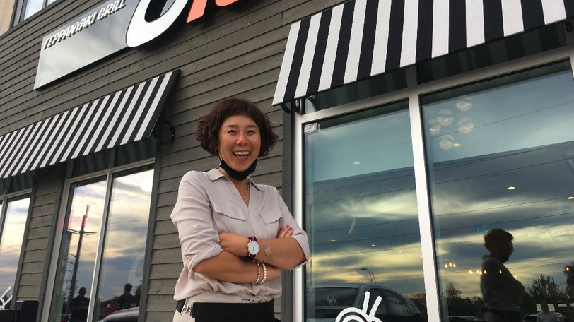 Ginny Hwang, owner of Olé Hibachi and Sushi, is shown outside her new restaurant in Dieppe on Saturday.