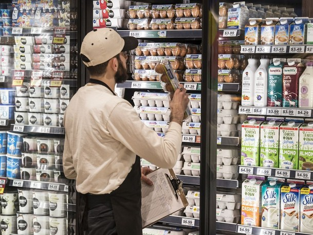 """A Farm Boy employee stocks eggs at the grocery stores newly opened location in north Burlington location, Thursday December 5, 2019. """"There's a bit of a brace yourself mentality as you walk into a grocery store,"""" says Dr. Sylvain Charlebois, professor and senior director of the AAL."""
