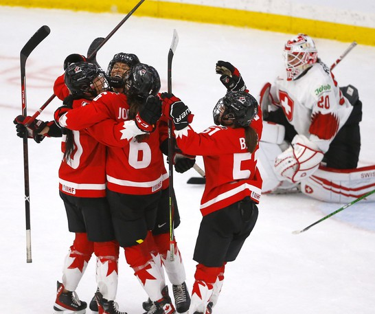 Team Canada's Rebecca Johnston scores on Team Switzerland's goalie Andrea Braendli in third period action during the 2021 IIHF Women's World Championship semi-finals at the Winsport arena in Calgary on Monday, Aug. 30, 2021.