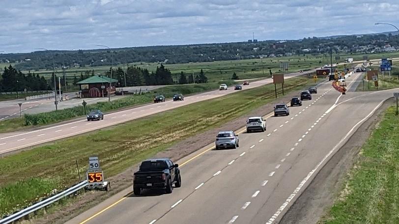 Cars and trucks approach the New Brunswick-Nova Scotia border near Amherst.
