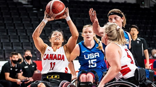 Canada's Tara Llanes scores two of her six points in a 63-48 loss to the United States in the women's wheelchair basketball quarter-finals at the Tokyo 2020 Paralympics.
