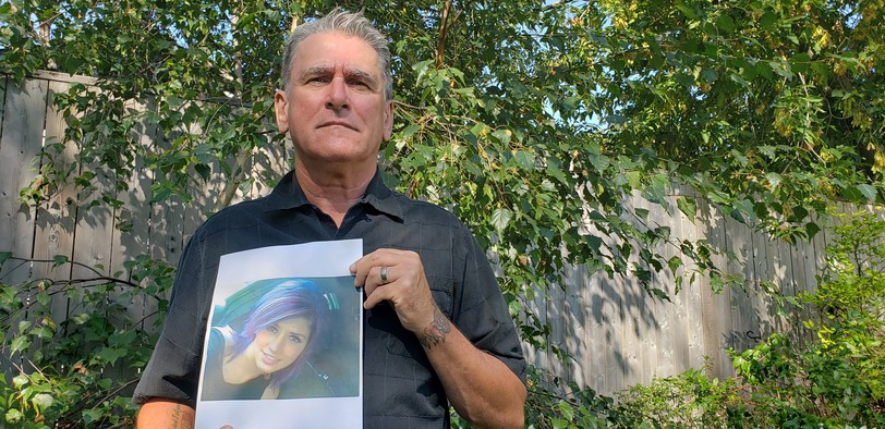Brent Springer holds a photo of his daughter Jami Springer, who has now been missing for five years after disappearing in Moncton in 2016.