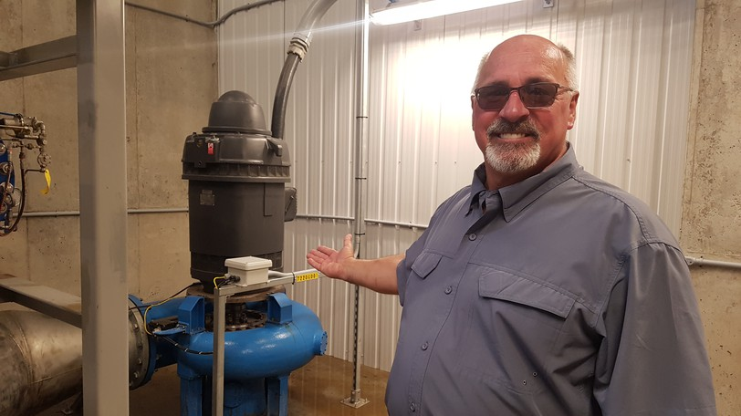 Dalhousie Mayor Normand Pelletier shows off the town's new hydroelectric turbine, which is powered by the water pressure in the large pipe that supplies the town with water. Dalhousie expects the project to provide between $85,000 and $105,000 per year in revenue from selling the energy to NB Power.