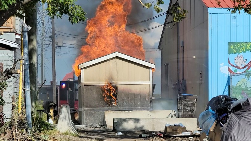 Bright orange flames roar out of a shed that caught fire on King Street Tuesday afternoon.