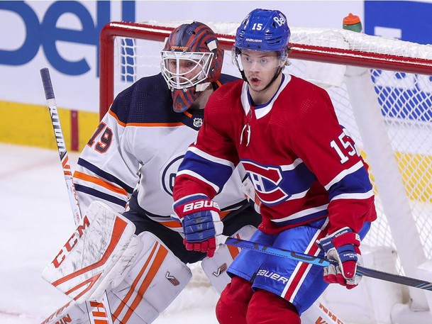 Montreal Canadiens forward Jesperi Kotkaniemi sets up in front of Edmonton Oilers goalie Mikko Koskinen during second period of an NHL game in Montreal last season.