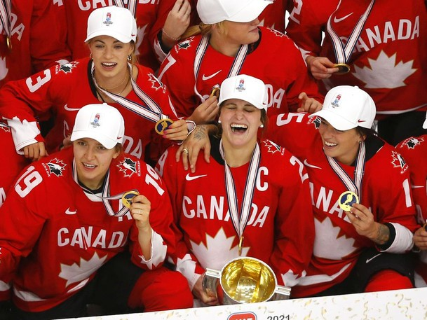 Team Canada celebrates after defeating Team USA in overtime to win the 2021 IIHF Women's World Championship gold medal at WinSport's Markin MacPhail Centre arena in Calgary on Tuesday, Aug. 31, 2021.