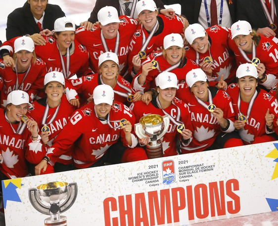 Team Canada celebrates after beating the United States 3-2 in overtime in the 2021 IIHF women's world hockey championship gold medal game at the WinSport Arena in Calgary on Tuesday.