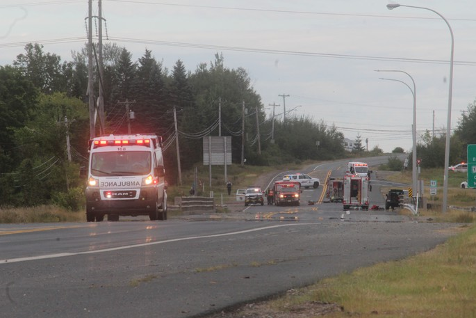 An ambulance leaves the scene Wednesday morning.