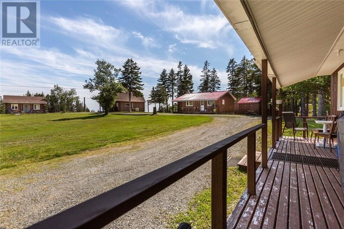 Several buildings and a view of the Bay of Fundy are the features of this property at 125 Forty Five Rdin Alma.