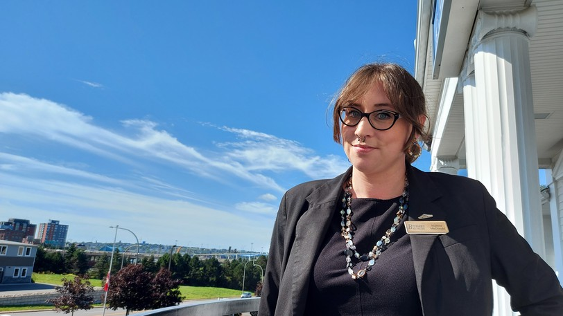 Saint John celebrant Sharlene MacDonald offers non-denominational funeral services through her business, Chuck Me in a Hole. She says her clients are looking for a non-traditional alternative for funeral services.