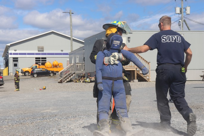 The Saint John Fire Department hosted a training session Wednesday with the Saint John Sea Dogs who learned the physical and teamwork skills that go into being a firefighter.