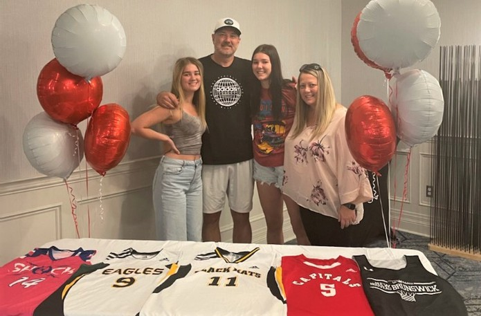 The Russell family, from left, Brooke, Bram, Bailey and Bridget gathered to celebrate 15-year-old Bailey's pending move to the Capital Courts Academy in Orleans, Ont., later this week. She'll play for the program there while attending Grade 11 this year. Seventeen year-old Brooke will play for FHS and is in the final tryouts for a travel team in Quebec.