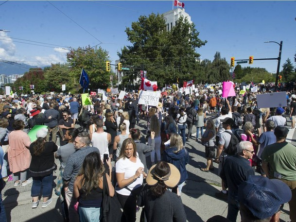Several thousand anti-vaccine protesters converge on Vancouver General Hospital as part of the World Wide Walkout for Health Freedom on Wednesday, Sept. 1.