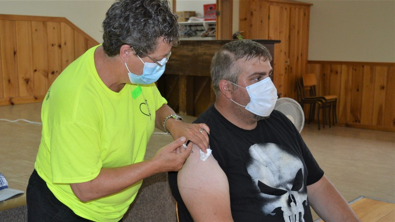 Jeremy Bowmaster received his COVID-19 vaccine from nurse Tina Pelletier during a July mobile clinic held in Plaster Rock in July. The Village of Plaster Rock will have another mobile clinic on Friday, Sept. 3 at the Plaster Rock Welcome Centre.
