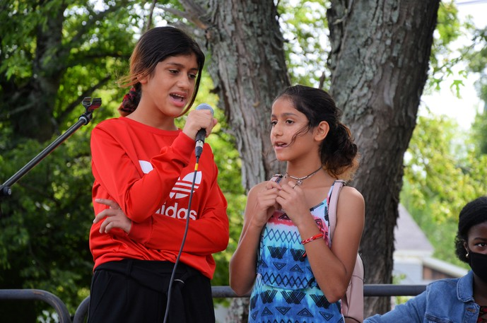 Ramas and Taz Ali sing O Canada at the Mayor's Welcome Barbecue Sunday at Elm Park.